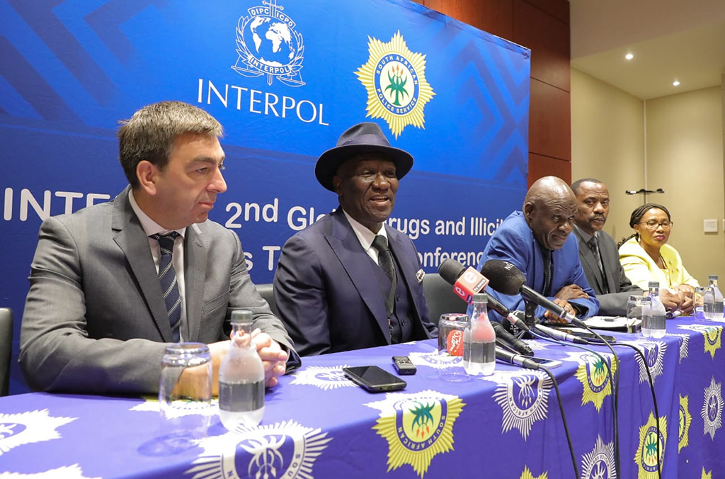 Officials speak to press during the 2nd INTERPOL Global Conference on Illicit Drugs