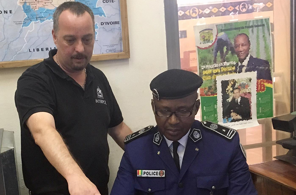 Didier Clergeot, Coordinator of INTERPOL's Integrated Border Management Task Force, and Naby Ibrahima Traoré, Head of Guinea's Security and Document Fraud Department, discuss INTERPOL's policing capabilities.