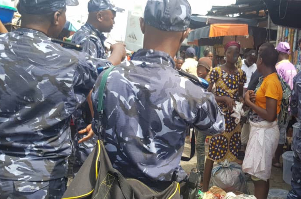 Some 100 officers across Benin and Nigeria carried out raids and identity checks at markets in Abuja and Cotonou.