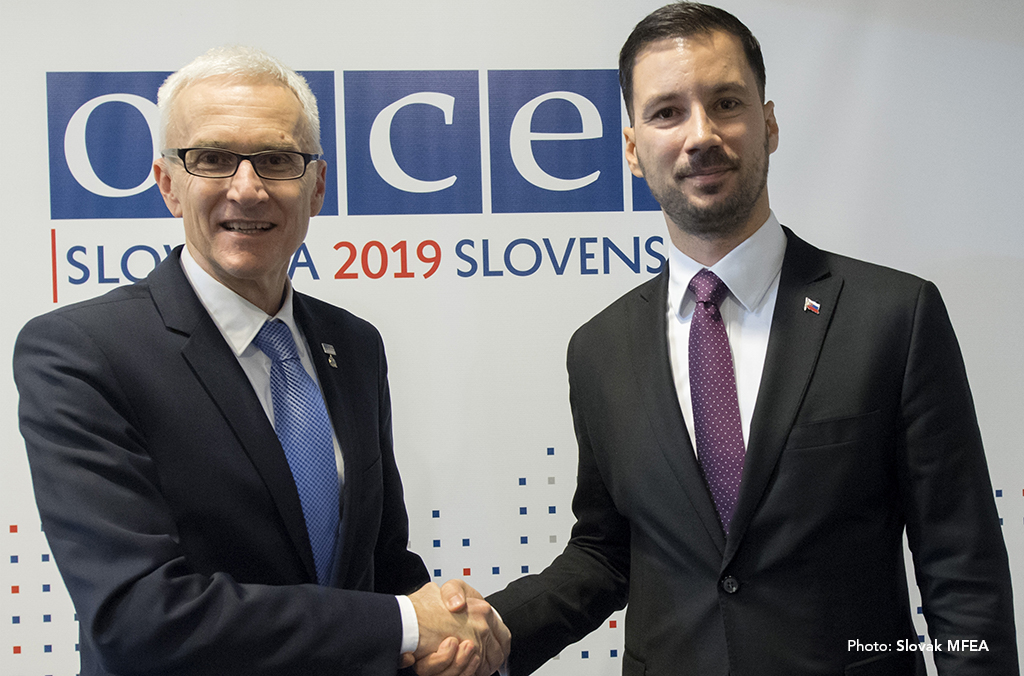 Secretary General Jürgen Stock is greeted by Lukáš Parízek, State Secretary of the Ministry of Foreign and European Affairs of the Slovak Republic