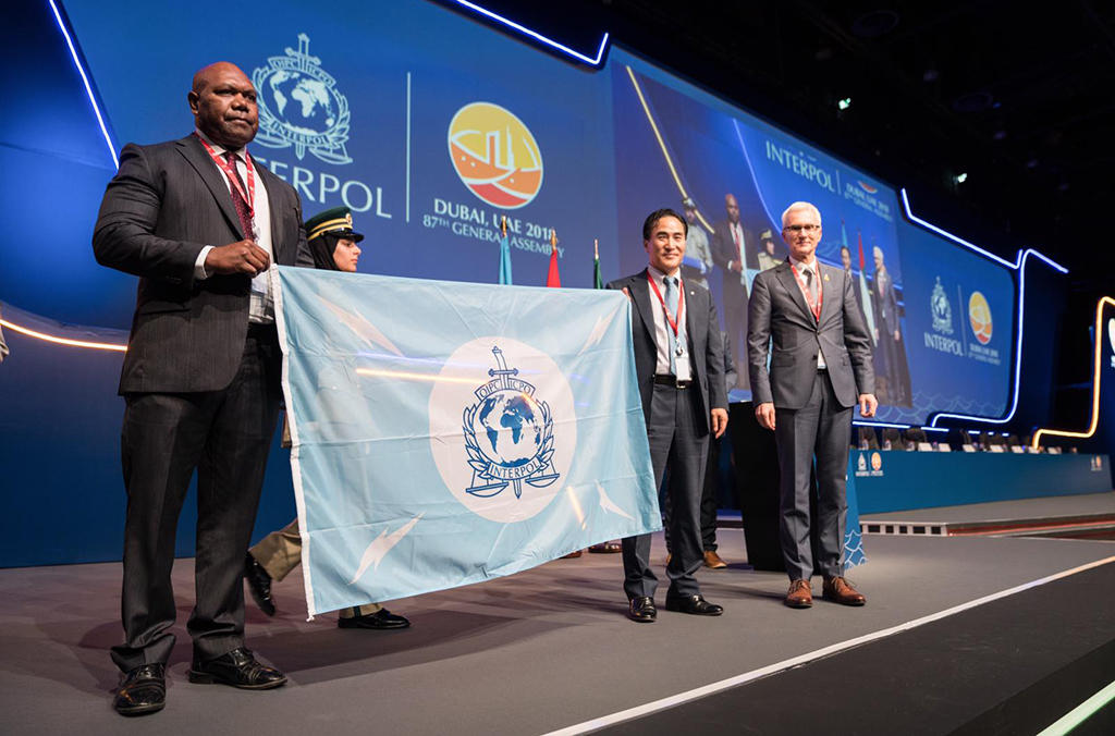 Vanuatu receives the INTERPOL flag as it becomes the 193rd member country of the Organization.