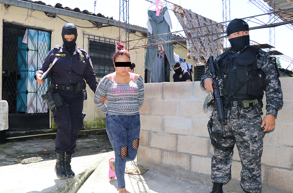 Police in El Salvador arrest a woman for human trafficking.