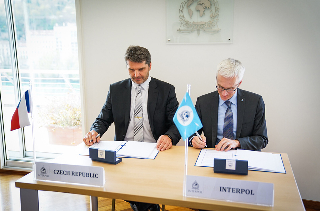 The Czech Police President symbolically hands over the new drug-tracking police tool to INTERPOL during a signing ceremony