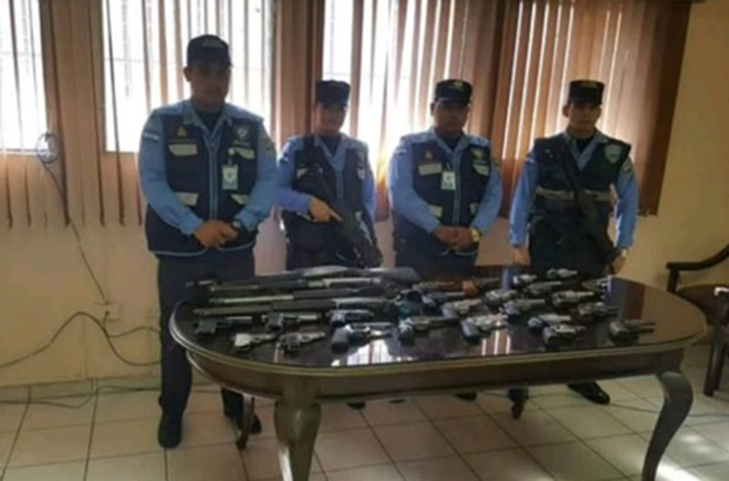 Honduran officials show some of the guns seized during Operation Trigger V.