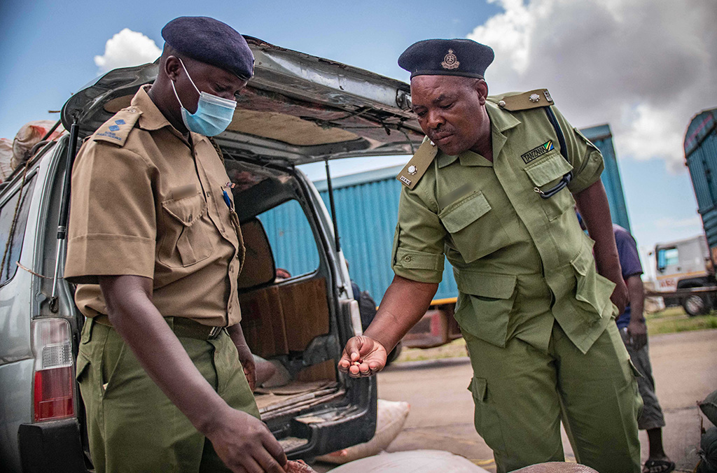 Police officers on the Kenya-Tanzania border inspect vehicles for signs of wildlife smuggling