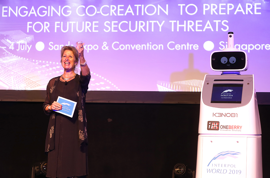 Anita Hazenberg, Director of INTERPOL's Innovation Centre, opened the event along with Kenobi the robot.