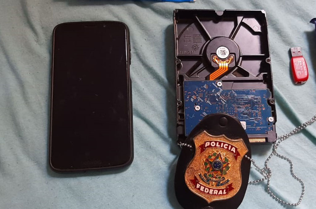 The suspect's seized devices contained additional, recent abuse material.