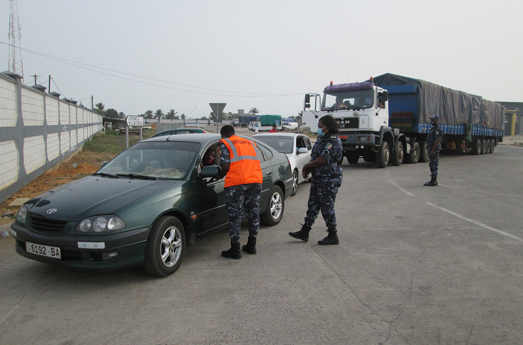 Officers in Benin carry out vehicle checks during Operation Weka.