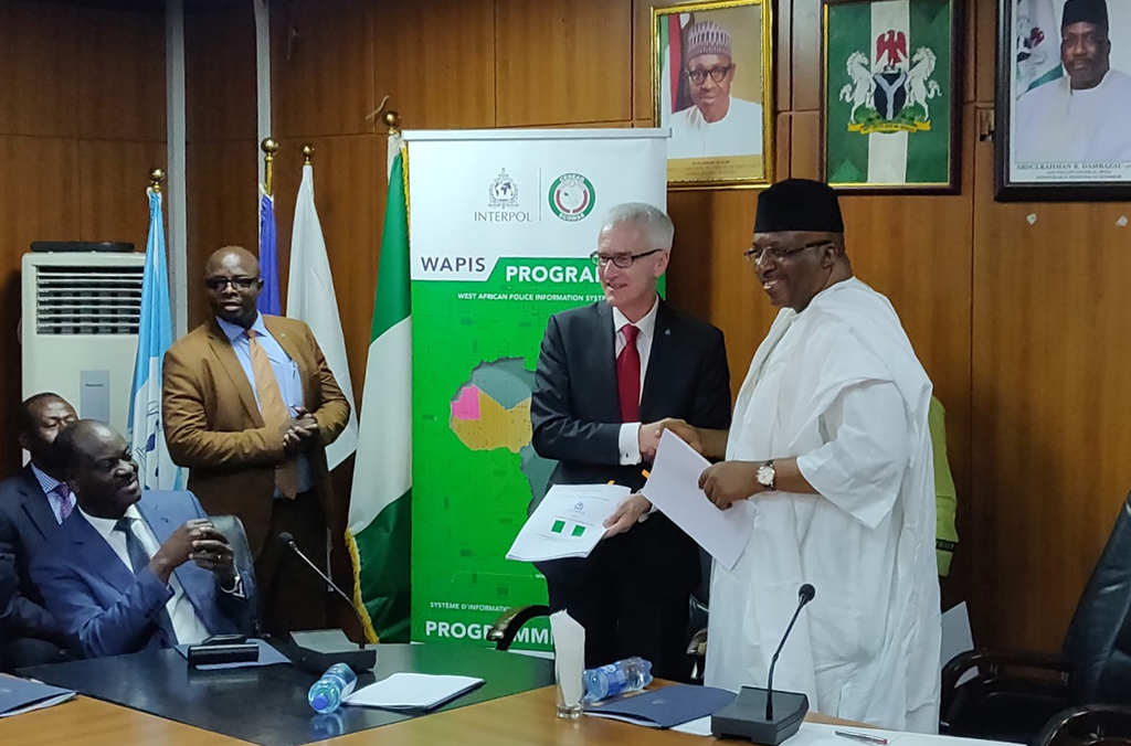 The agreement signing ceremony with Nigeria's Minister of the Interior and INTERPOL Secretary General Jürgen Stock for the implementation of the West African Police Information System programme.