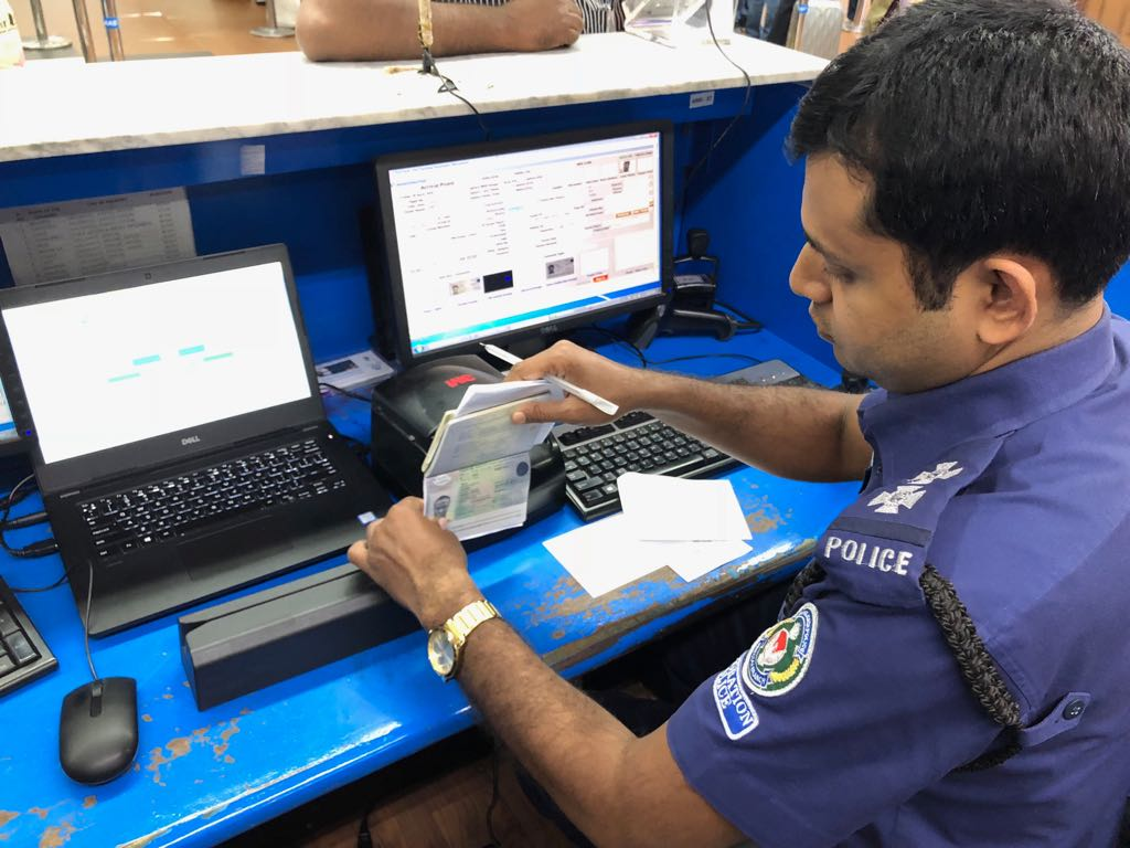 Immigration Police scanning with MIND Devices at Shahjalal International Airport