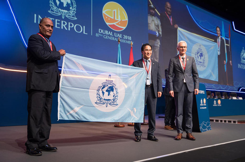 Kiribati receives the INTERPOL flag as it becomes the 194th member country of the Organization.